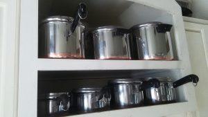 Set of Vintage copper-clad RevereWare pots.